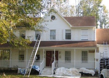 Preparing a house for painting.